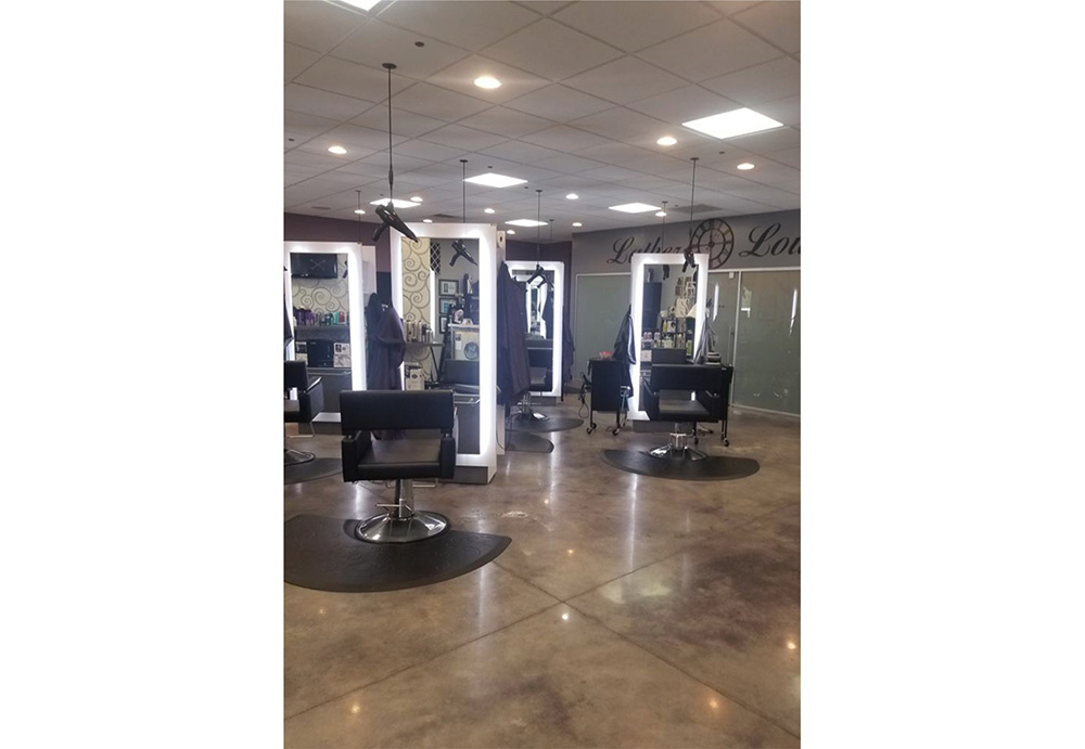Hair salon floor plan featuring black hydraulic salon styling chairs on top of black floor mats facing mirrors.