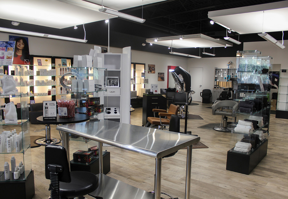 Example salon floor plan with hair products along wall, tables, and salon chairs.