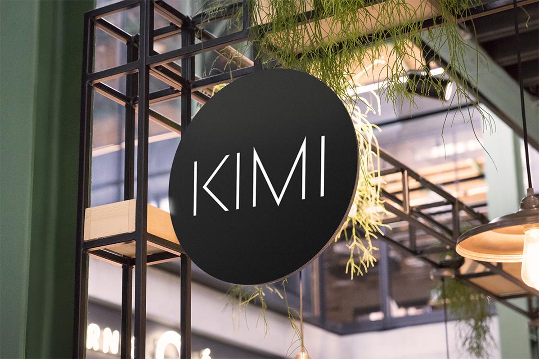 Salon brand design for KIMI displayed on a circular sign.