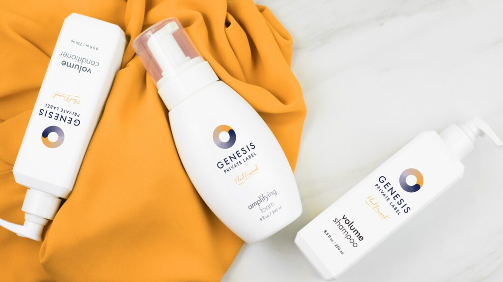 three bottles of genesis private label hair products